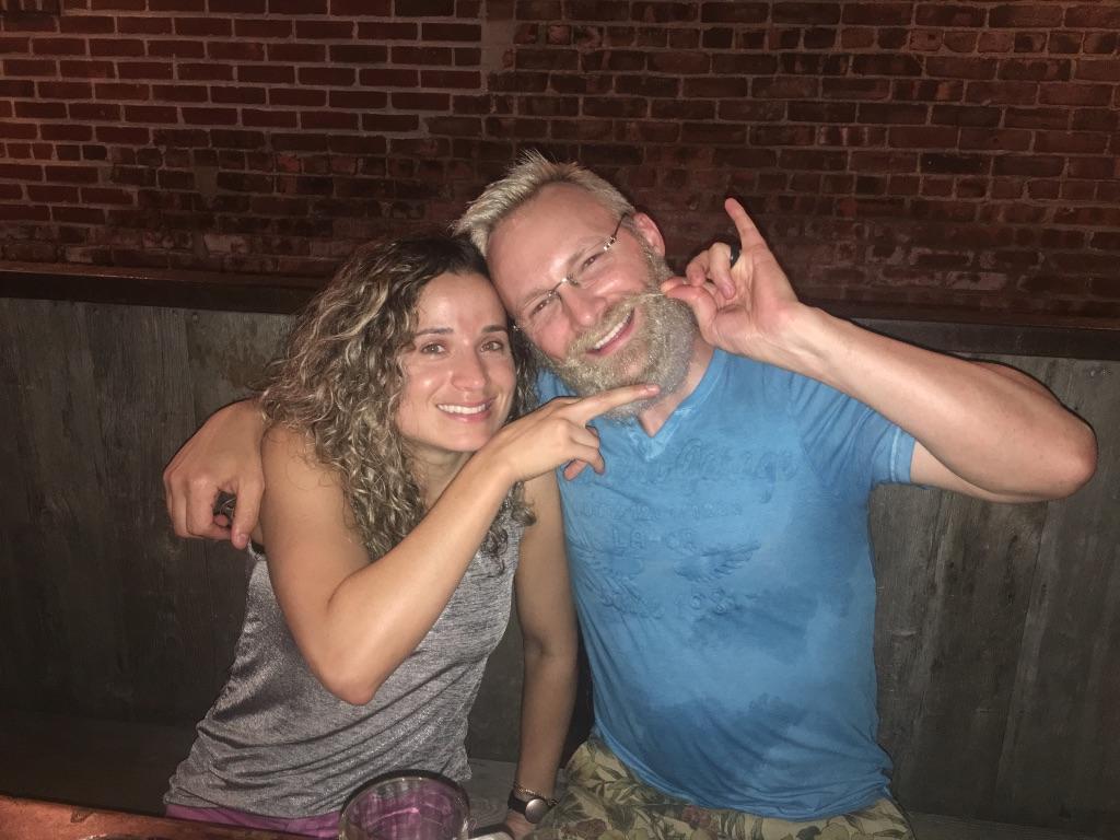 Dan and Emille hanging out at a restaurant poking fun of Dan's long blonde beard