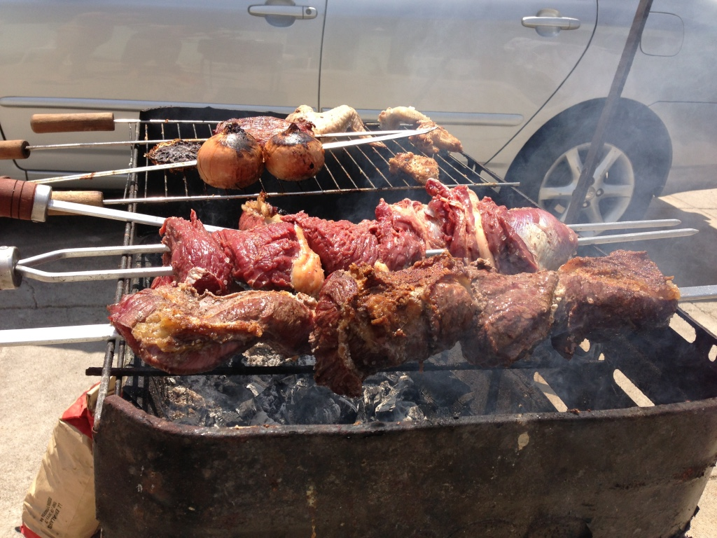 Brazilian churrasco cooking on a grill