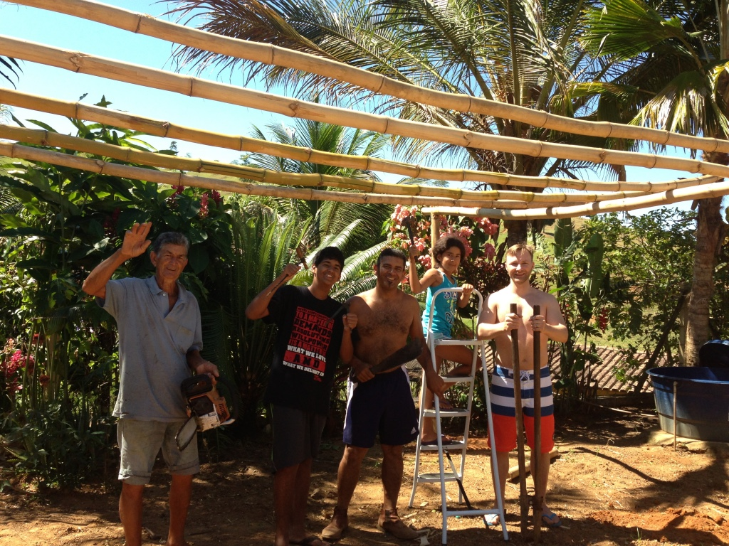 Family in Brazil posing with a cabana being built