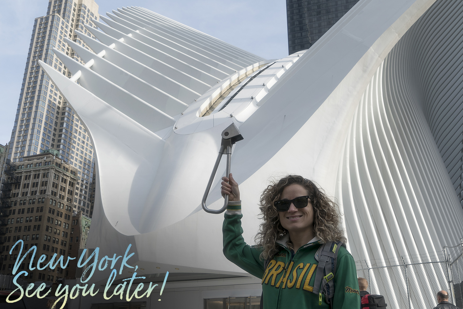Emille holding the Subway Handle in front of the Oculus in NYC
