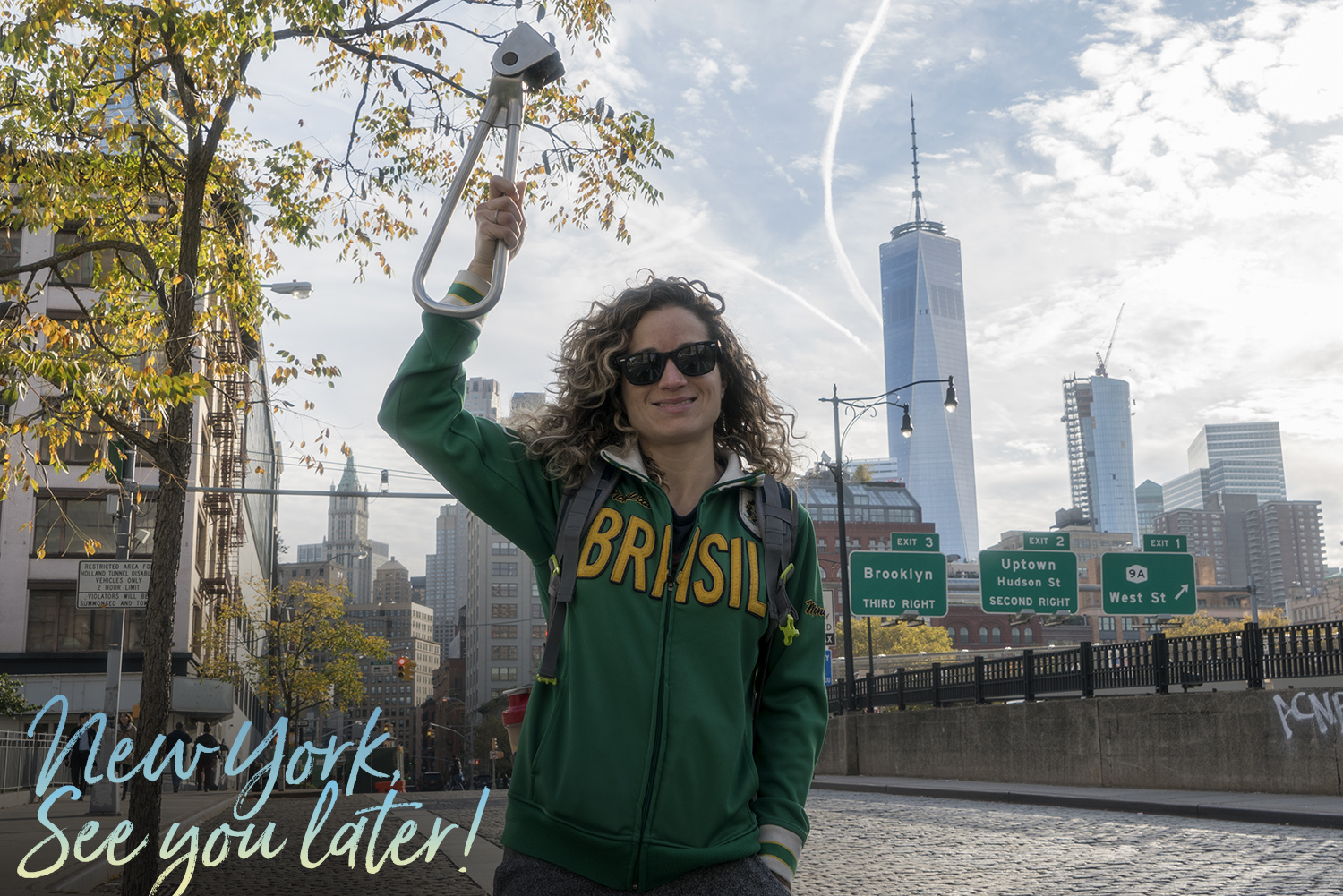 Emille holding the Subway Handle in NYC with the World Trade Center in the background