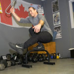 CrossFit Banff, Will demonstrates a pistol pose on one leg with the Subway Handle