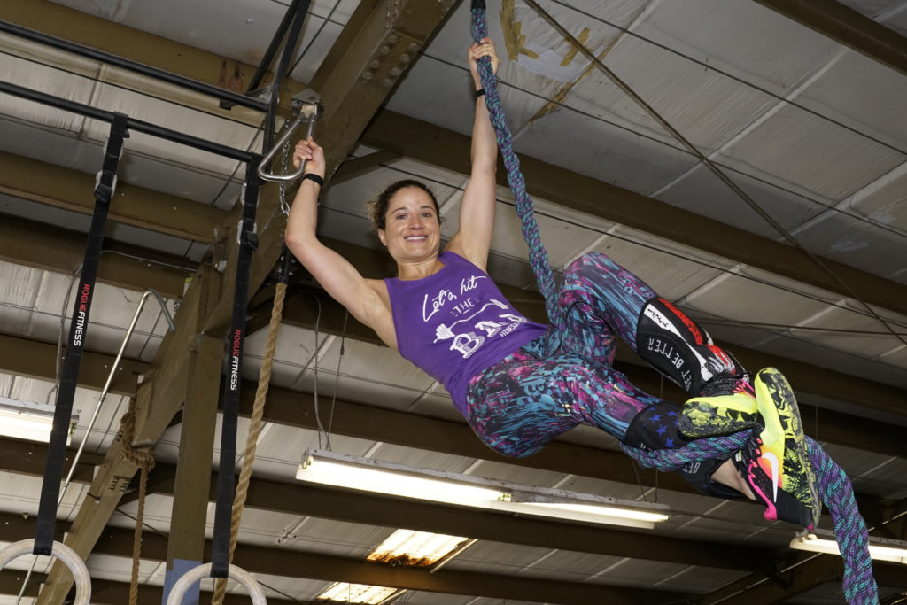 "Emille does a ""Subway Handle Rope Climb"""