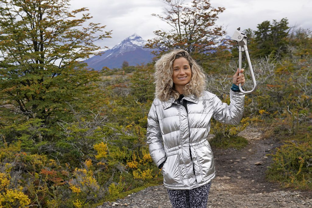 Emille from NY See You Later holding the NYC Subway Handle in Torres del Paine, Puerto Natales, Chile