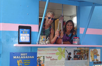 Dan holding the Subway Handle with the owner in the Hot Malasadas Truck on The Big Island of Hawaii