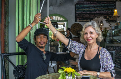 Aesp and Fiona and Fiona holding the Subway Handle in Silk Road Whole Foods in Canggu, Bali, Indonesia by NY See You Later