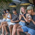 Daia, Emille, Ilsa and Atiba are hapily holding adorable puppies, while Ali is left out holding the NYC Subway Handle at Cafe Cinta Canggu, Bali, Indonesia