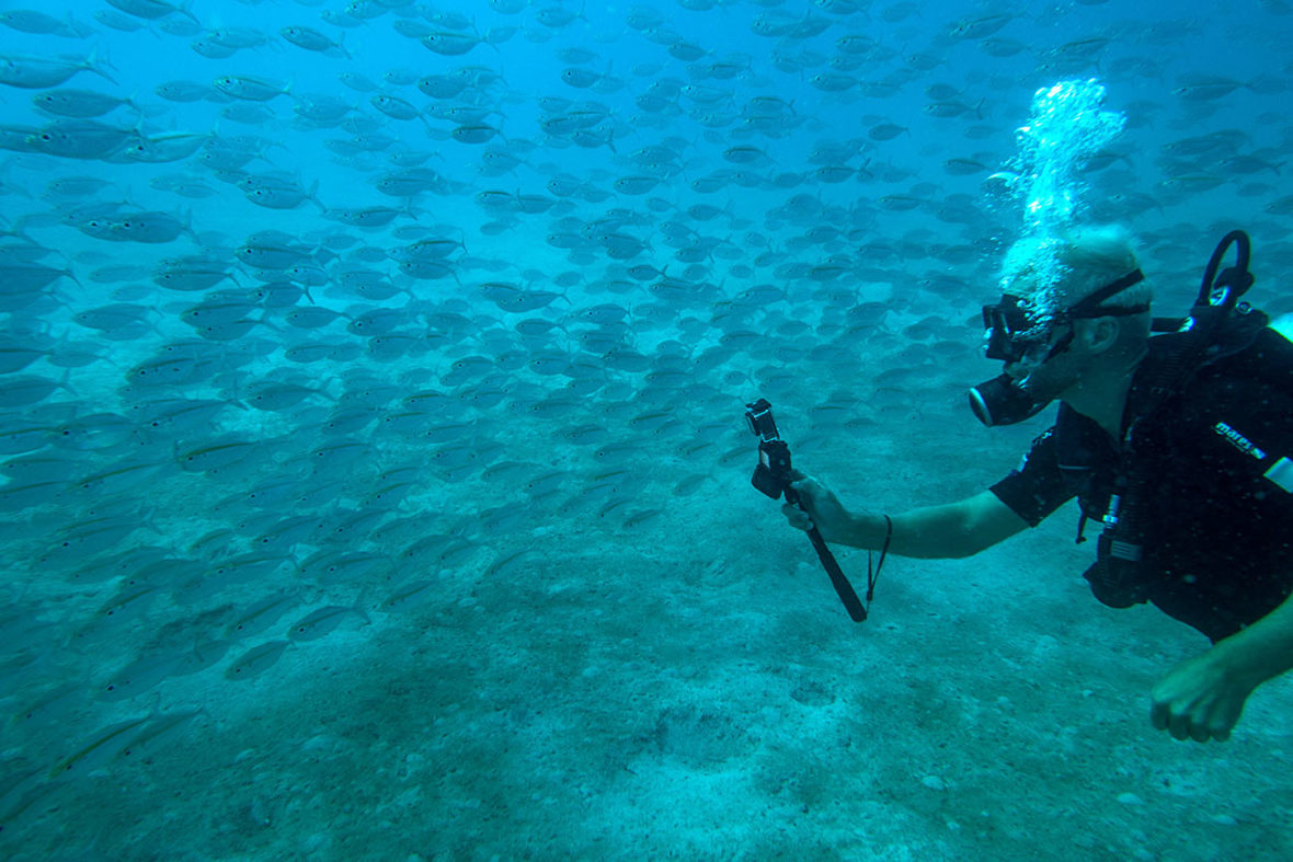 Photo of a Matahari Diver holding the Subway Handle in the Perhentian Islands, Malaysia. We went diving Police Wreck and Batu Caping.