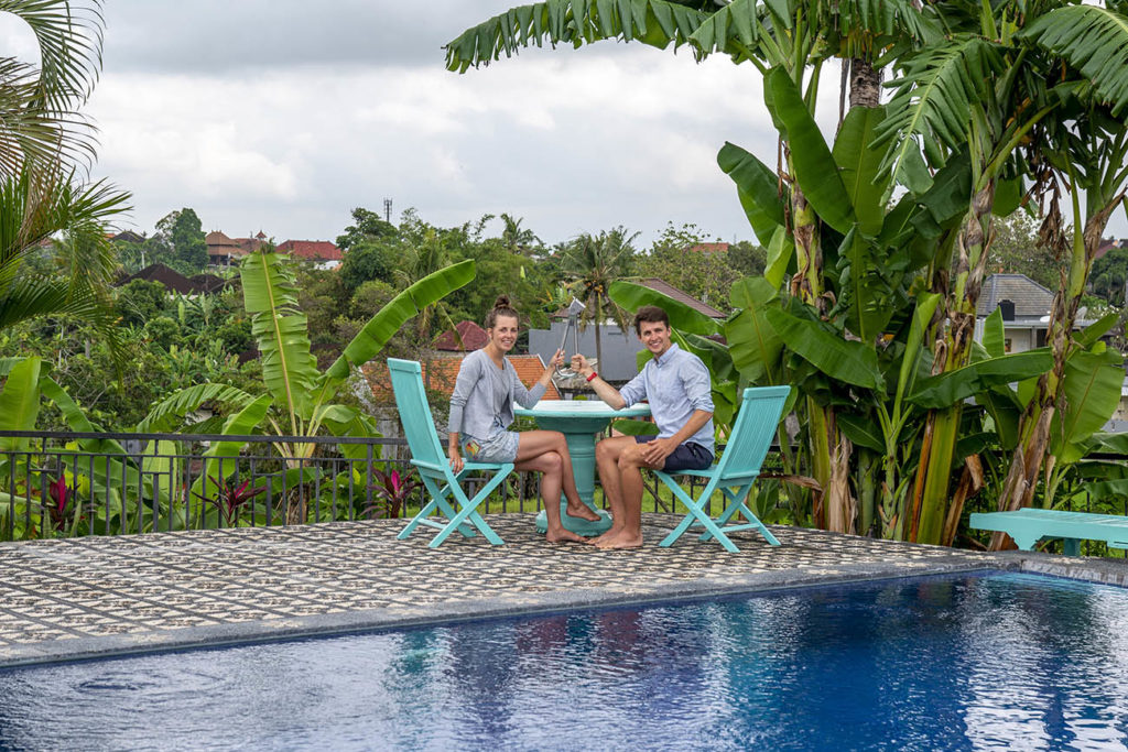 Nicka and Daniel, the newlyweds, prepare for a romantic dinner with the NYC Subway Handle in Canggu, Bali, Indonesia