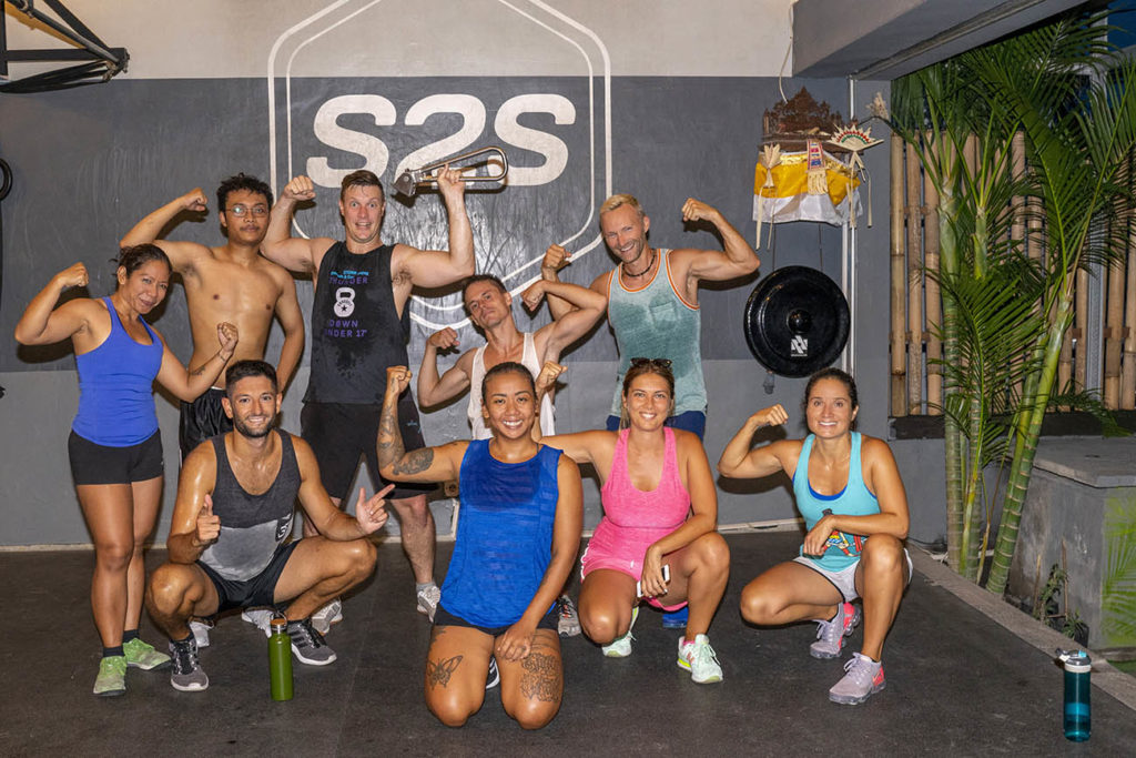 New friends at CrossFit S2S pose with the NYC Subway Handle in Canggu, Bali, Indonesia