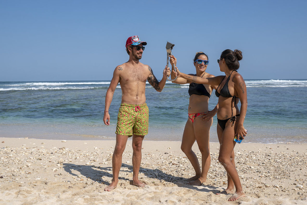 Steven, Emille and Larisa holding the subway handle at Greenbo Beach in Canggu, Bali, Indonesia
