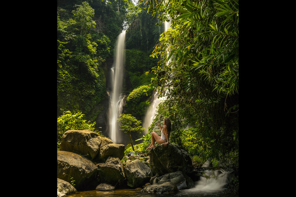 Emille holding the NYC Subway Handle at the Sekumpul Waterfall, Bali, Indonesia