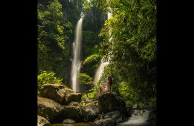 Emille holding the NYC Subway Handle at the Sekumpul Waterfall, Bali, Indonesia