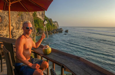 Dan holding the NYC Subway Handle at Uluwatu Beach, Bali, Indonesia