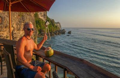 Dan holding the NYC Subway Handle at Uluwatu Beach, Bali, Indonesia
