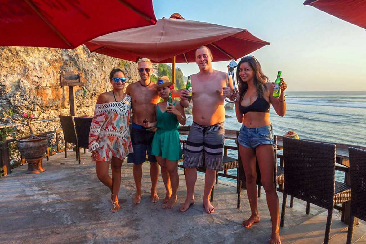 Emille, Dan, Natalie, Kyle and La'akea holding the NYC Subway Handle at Uluwatu Beach, Bali, Indonesia